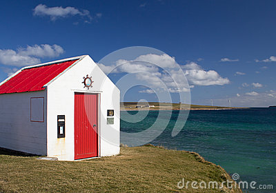 Small building by ocean