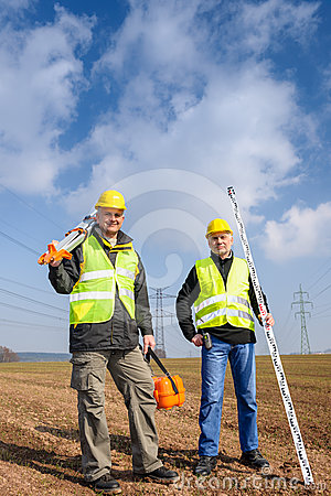 Geodesist two man equipment on construction site
