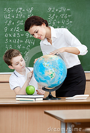 Geography teacher shows something to the pupil