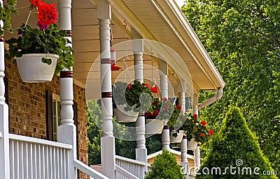 Geranium pots hanging on porch