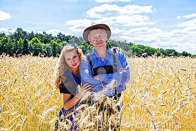 German couple in tracht on the field