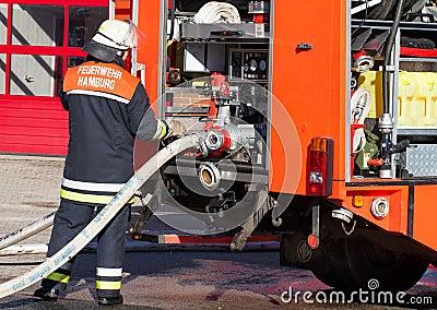 German fire Department firefighter on Fire Truck 2 Stock Photo