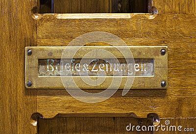 German mails slot in wooden door