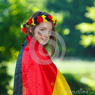 German soccer fan surrounded of german flag