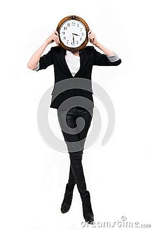 Geschäftsfrau mit Borduhr ful Höhe - setzen Sie Zeit Konzeptes fest