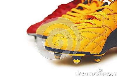 Geïsoleerde de laarzen van de voetbal