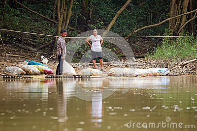 Getting across the river with the raft Editorial Image