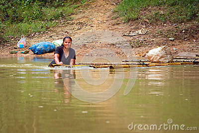 Getting across the river with raft in Thailand Editorial Photography