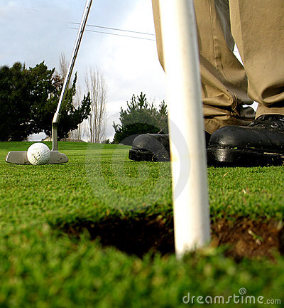 Getting ready to sink the putt