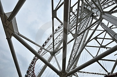 Giant Ferris Wheel and Cloudy Day