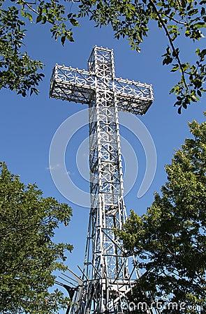 Giant Metal White Cross Against Blue Sky