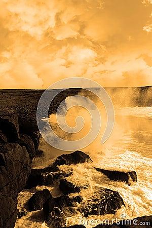 Giant storm waves crashing on cliffs
