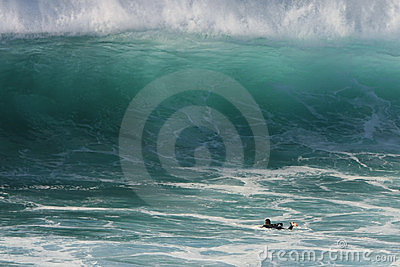 Giant wave and a lone surfer