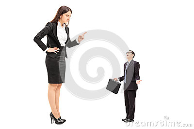 Giant woman threatening a tiny businessman