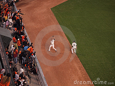 Giants Outfield grabs flyball on the warning track Editorial Stock Photo