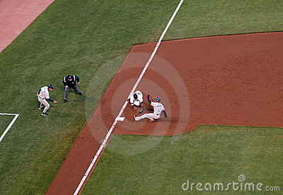 Giants third baseman reaches to tag baserunners Editorial Photo