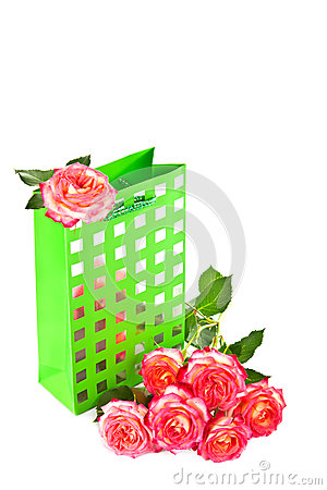 Gift bag and a bouquet of roses.
