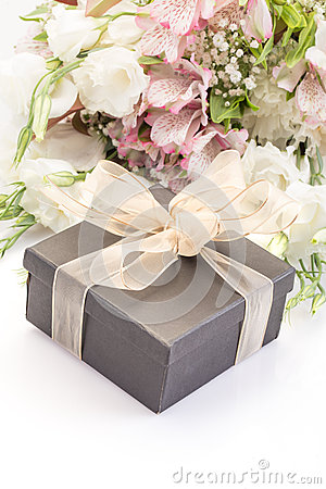 Gift on bouquet of flowers