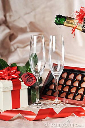 Gift in box and champagne