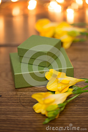 Gift box with flowers and evening lighting