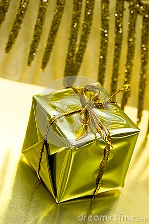 Gift box on golden background