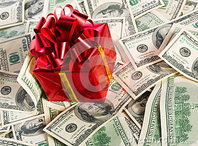 Gift box on heap of money