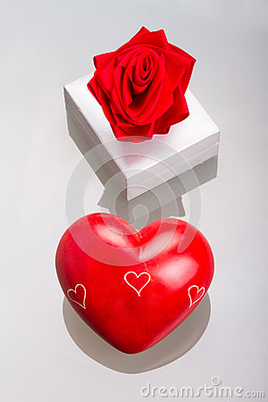 Gift box with red heart as love symbol