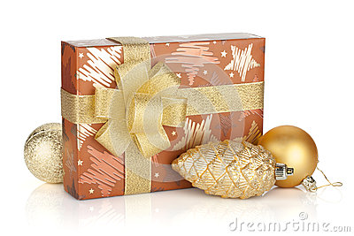 Gift box with ribbon, bow and christmas decor