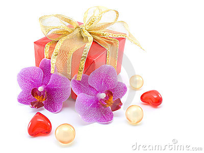 Gift box with ribbons and orchid