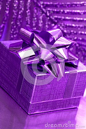 Gift box on violet background
