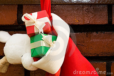 Gift boxes in a Christmas sock