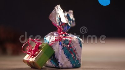 Gift boxes on table with lights in background stock video
