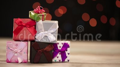 Gift boxes on table with lights in background stock video footage
