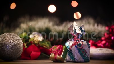 Gift boxes and decorations on table with lights in background stock footage
