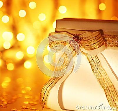 Gift over abstract Christmas lights