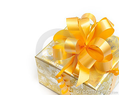 Gift packed in golden paper on white