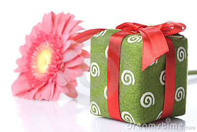 Gift with pink daisy-gerbera
