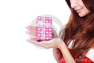 Gift and smiling christmas woman