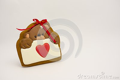 Gift for Valentine`s Day. Original gingerbread, a bear with a heart Stock Photo