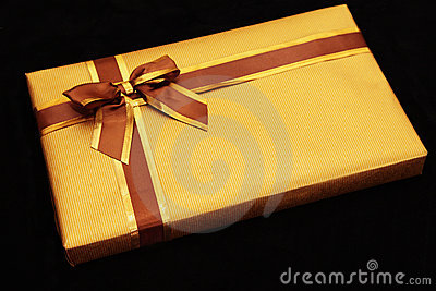 Gift wrapped in gold with brown/gold ribbon