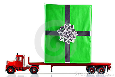 Gift wrapped present being delivered by truck