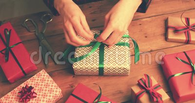 Gift wrapping. woman tie a green ribbon bow stock video