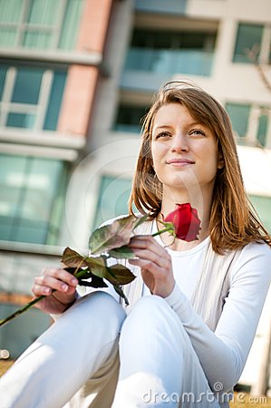 Gift - young woman with red rose