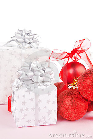 Gifts and red christmas balls. Festive background.