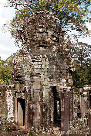 Gigantic Face Statues At Khmer Temple