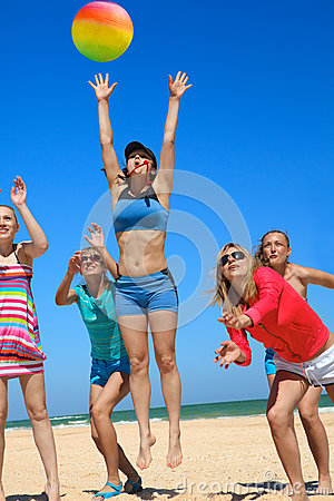 Giirls playing volleyball