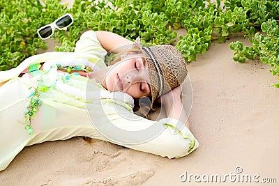 Gilr lying on beach