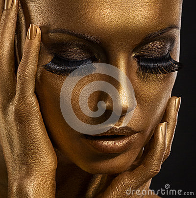 Gilt. Golden Woman s Face Closeup. Futuristic Giled Make-up. Painted Skin