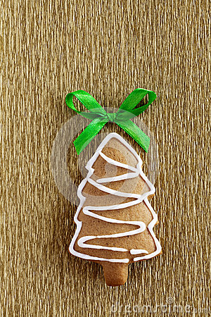 Ginger Christmas cookie on gold background