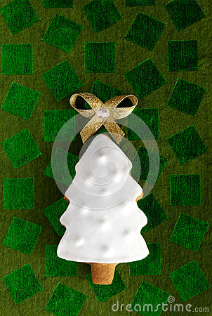 Ginger Christmas Fir tree on green background